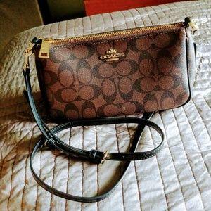Coach cross body purse .